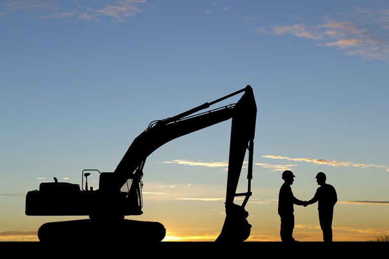 Construction Handshake at Sunrise